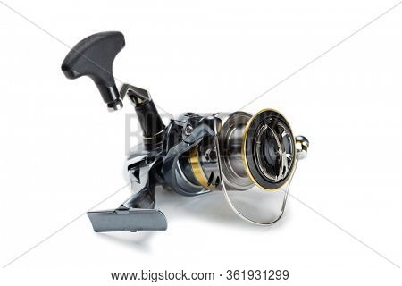 Inertialess fishing reel modern model isolated on white background