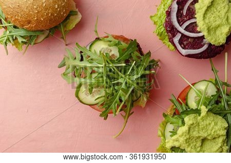 Veggie Beet And Lentil Burgers With Vegetables And Avocado Sauce. Healthy Food Concept.