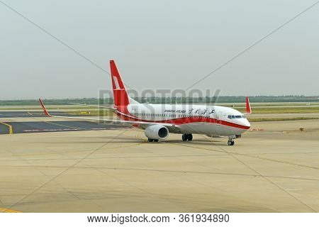 Shanghai, China - Oct. 10, 2015: Shanghai Airlines 737-800 At Pudong International Airport In Shangh