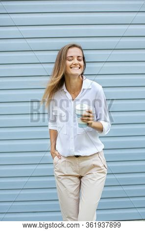 Attractive Woman Holding Reusable Coffee Mug. Eco Friendly Concept.