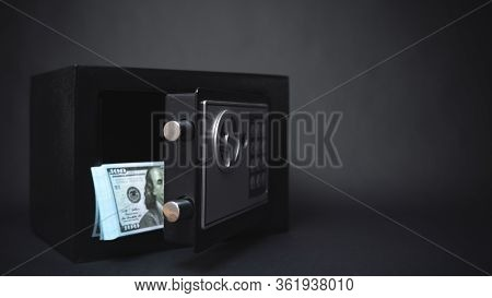 Cash Money Safe Deposit. Symbol Of Money Safety. Small Residential Vault With Pile Of Cash Money. To