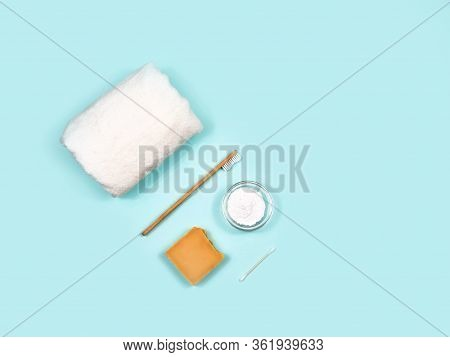 Zero Waste Concept. Toothbrush, Tooth Powder, Towel And Soap On A Blue Background. Eco-friendly Bamb