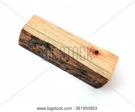 One Wooden Log Isolated On A White Background.