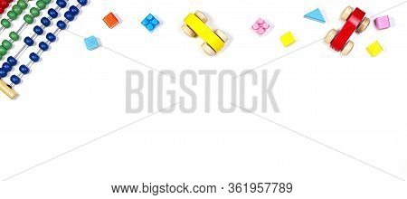 Baby Kids Toys Banner Background. Toy Abacus, Wooden Cars And Bricks On White Background. Top View,