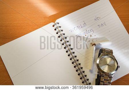 No Smoking, Anti-tobacco, World No Smoking Day, Top View Of Broken Cigarettes, Notepad, Wrist Watch,