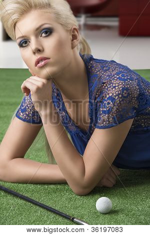 Sexy Blonde Girl Pays Golf Lying On The Grass