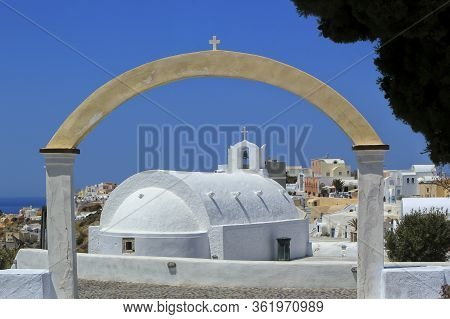 Small White Church In Oia By Day, Santorini Island, Greece