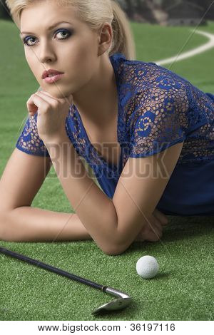 Sexy Blonde Girl Pays Golf With Hand Under The Chin
