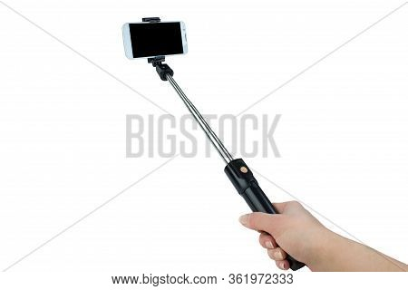 Taking Selfie - Hand Hold Monopod With Mobile Phone.
