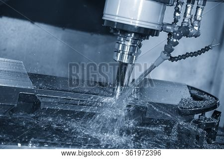 The Cnc Milling Machine Rough Cutting The Mold And Die Parts With Liquid Coolant Method. The Mold An