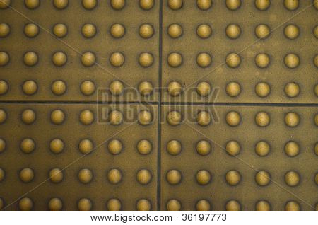 Floor tile surface on the footpath for a blind