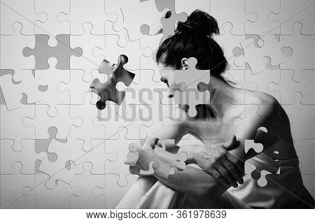 Jigsaw Puzzle Of Mature Brunette Woman Sitting And Contemplates The Realities Of Life