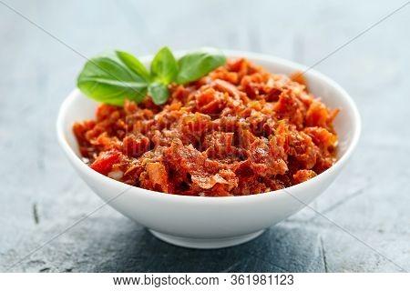 Sun Dried Tomato Pesto In White Bowl.