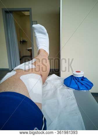Human Leg With Patches During Rehabilitation Exercises After Anterior Cruciate Ligament Surgery.