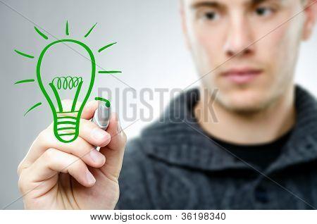 Man Draws A Green Bulb