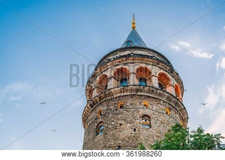 Gallata Tower In Istanbul, Turkey. The Tower Is Photographed In Close-up On Background Of Blue Sky.