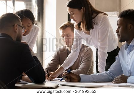Multiracial Diverse Businesspeople Cooperating At Office Meeting