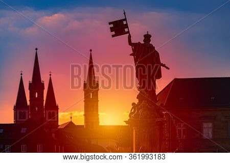 Sunset Over City Of Wurzburg In Bavaria, Germany. Beautiful Sky With Sun And Clouds In Background An