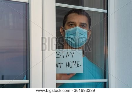 Medical Mask, Protection Against Coronavirus And Other Viruses. Young Attractive Man In A Blue Cloth