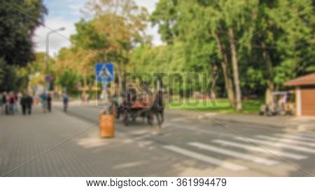 Blurred Background Of A City Street. Urban Landscape. Creative Theme With Blur And Bokeh Effect For
