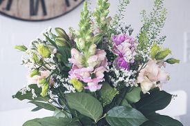 Beautiful Boquet Of Flowers In Various Colors In A Romantic Ornament