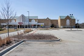 LINCOLNSHIRE, IL - APRIL 7, 2020: An empty Century Theatres and an empty parking lot depicts the results of quarantine, social distancing and home isolation during the coronavirus pandemic.