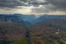 A Valley In Sunshine And Clouds In The Blue Mountains In Australia