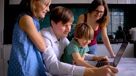 Stay Home Concept. Cute Children Use Laptop For Education, Online Study. Boy And Girl Have Homework