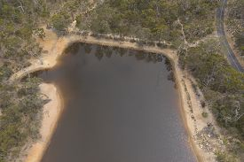Aerial Photograph Of A Drought Affected Water Reservoir In Rural Australia