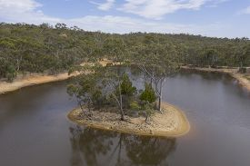 Aerial Photograph Of A Drought Affected Water Reservoir And Small Island In Rural Australia