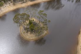 Aerial Photograph Of Small Island In A Drought Affected Water Reservoir In Regional Australia