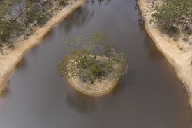 Aerial Photograph Of Small Island In A Drought Affected Water Reservoir In Rural Australia