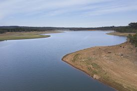 Aerial View Of A Fresh Water Reservoir In Rural Australia Which Is Reducing Due To The Extreme Droug