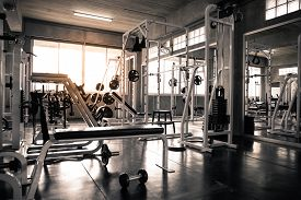 Within Gym With Modern Fitness Equipment.