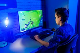 Teenage Boy Playes Videogames. Addicted To Video Gaming At Home