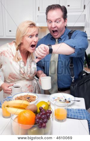 Panicked Couple In Kitchen Late For Work