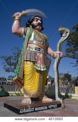 Mahishasura Mardhini the one who vanquished the demon Mahishasura Chamudeeswari or Dura is the fierce form of Shakti. Colorful gigantic image of the demon. Found at summit of Chamundi Hill. poster