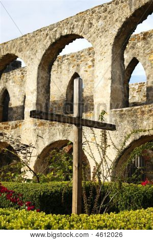 Rugged Cross In Stone Courtyard