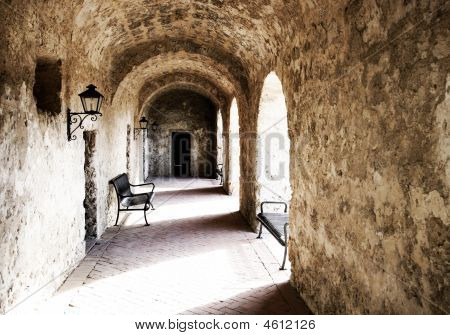 Stone Arched Walkway With Light & Shadow