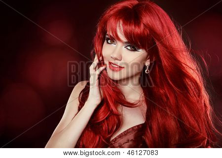 Portrait Of Beautiful Girl With Healthy Long Red Hair And Makeup. Wavy Hair.hairstyle. Make-up. Happ