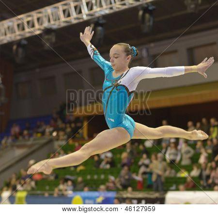 KIEV, UKRAINE - MARCH 31: Unidentified female gymnast performs exercise on balance beam during International Tournament in Artistic Gymnastics Stella Zakharova Cup in Kiev, Ukraine on March 31, 2013