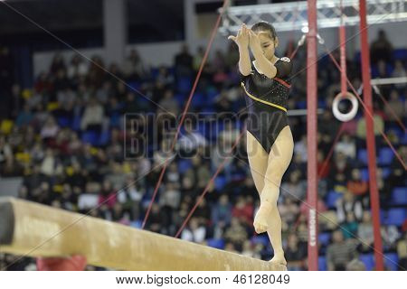 KIEV, UKRAINE - MARCH 31: Minobe Yu, Japan performs routine on balance beam during International Tournament in Artistic Gymnastics Stella Zakharova Cup in Kiev, Ukraine on March 31, 2013