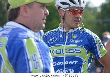 KIEV, UKRAINE - MAY 24: Vitaly Buts with teammates from Kolss cycling team, Ukraine, on the finish of Race Horizon Park in Kiev, Ukraine on May 24, 2013