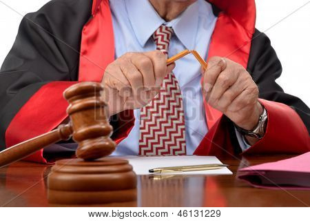 Senior judge breaking pencil isolated on white background.  Breaking pencil means death penalty according to some judiciary systems.