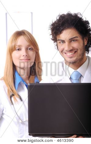 Young Doctors Use Laptop