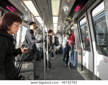 People Ride The Airbart Automated People Mover At Sfo