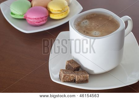 Cup Of Coffee And Colorful Macaroon