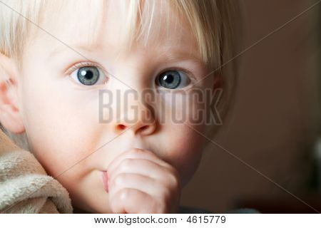 Young Child Sucking Her Thumb.