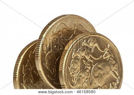 Australian one dollar coins, on edge, over white background.