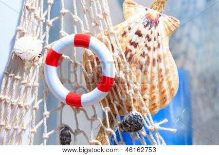 Fishing net with buoy and shell summer background